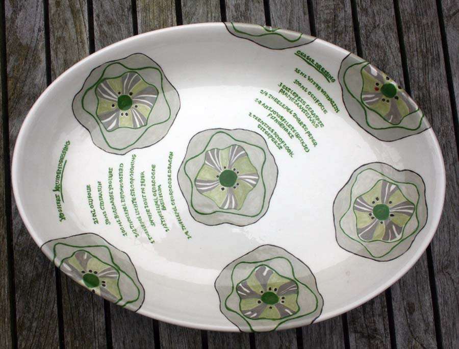 Ovale schaal salade met recept voor dressing